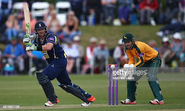 Ian Bell of Warwickshire hits the ball towards the boundary as Chris Read of Nottinghamshire looks on during the Royal London OneDay Cup match...