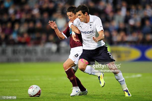 Ian Black of Hearts battels for the ball with Gareth Bale of Tottenham during the UEFA Europa League Playoff first leg match between Heart of...