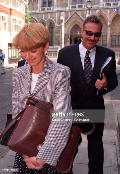 Ian Botham and his wife Kathy leave the High Court today where he and former England cricketing colleague Allan Lamb are suing former Pakistan...