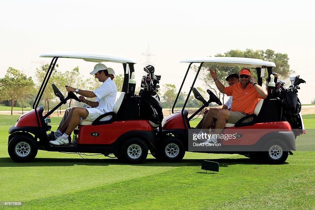 Ian Botham gives Michael Vaughan a push in his buggie after it breaks down during the Laureus World Sports Awards Golf Challenge at the Abu Dhabi...