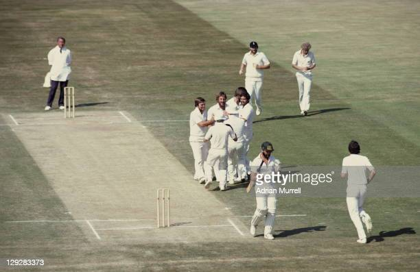 Ian Botham is congratulated by his England team mates after dismissing Ray Bright of Australia with a first ball Leg Before Wicket during the 2nd...