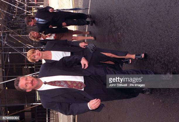 Ian Botham leads his wife Kathy and Allan and Lindsey Lamb into the High Court this morning for their ongoing libel action against former Pakistani...