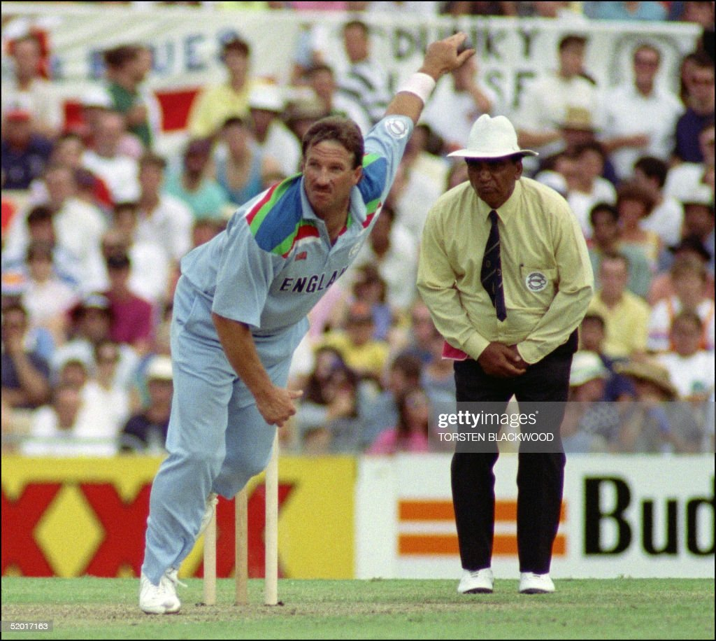 Ian Botham of England follows through during the World Cup cricket match against Australia in Sydney 05 March 1992 in which he took 4 wickets and...