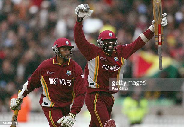 Ian Bradshaw and Courtney Brown of West Indies celebrate scoring the winning runs during the ICC Champions Trophy Final between England and the West...