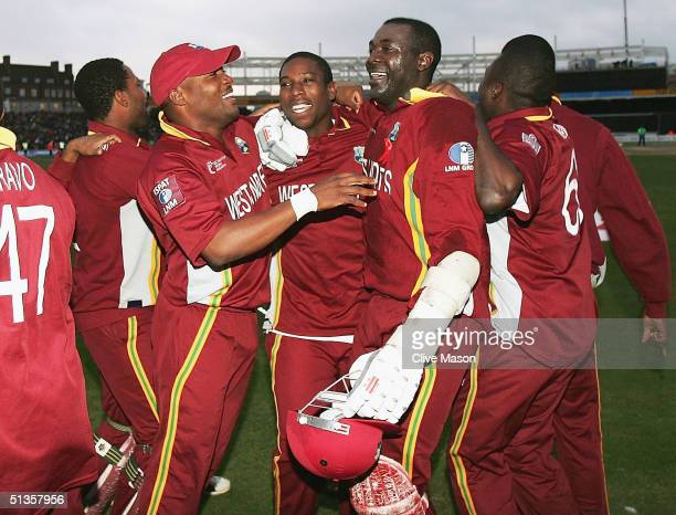 Ian Bradshaw of West Indies celebrates with skipper Brian Lara after victory in the ICC Champions Trophy Final between England and the West Indies at...