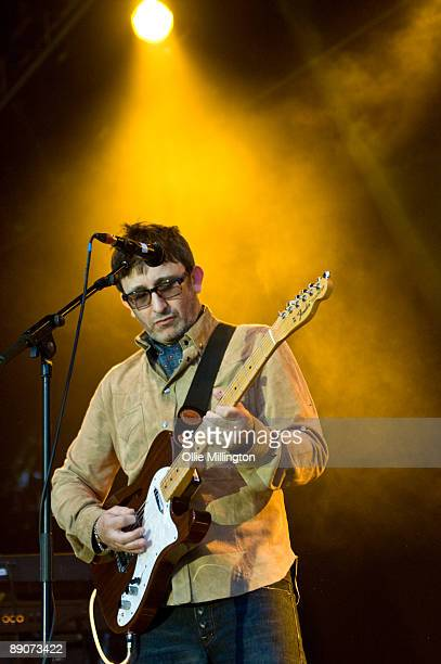 Ian Broudie of The Lightning Seeds performs on stage on the second day of Guilfest at Stoke Park on July 11 2009 in Stoke Poges England