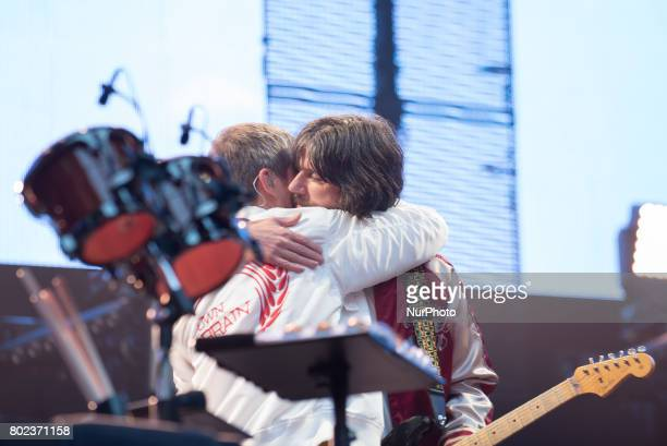Ian Brown and John Squire hug each other before British iconic rock band The Stone Roses perform on stage at Wembley Stadium London on June 17 2017...