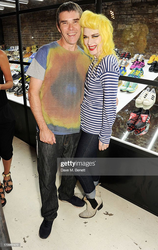 Ian Brown (L) and Pam Hogg attend the launch of the adidas #Spezial exhibtion, showcasing 600 pairs of adidas trainers, at Hoxton Gallery on July 18, 2013 in London, England.
