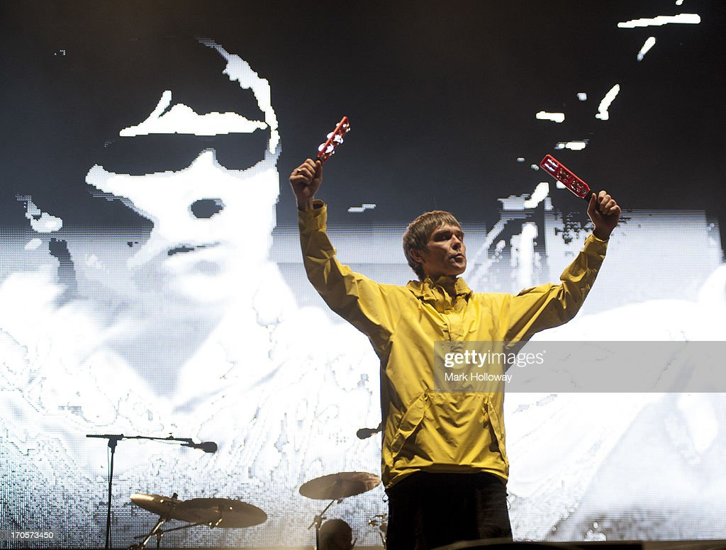 <a gi-track='captionPersonalityLinkClicked' href=/galleries/search?phrase=Ian+Brown&family=editorial&specificpeople=210705 ng-click='$event.stopPropagation()'>Ian Brown</a> of The Stone Roses performs on stage on Day 2 of Isle Of Wight Festival 2013 at Seaclose Park on June 14, 2013 in Newport, Isle of Wight.