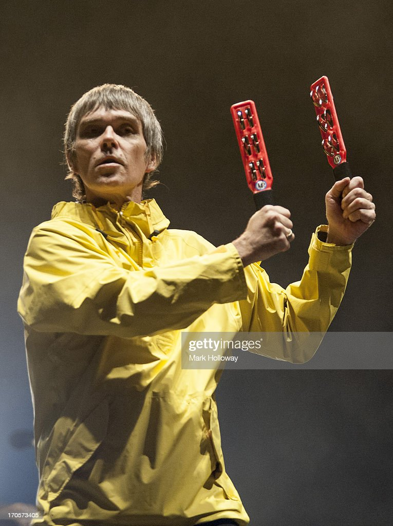 <a gi-track='captionPersonalityLinkClicked' href=/galleries/search?phrase=Ian+Brown&family=editorial&specificpeople=210705 ng-click='$event.stopPropagation()'>Ian Brown</a> of The Stones Roses performs on stage on Day 2 of Isle Of Wight Festival 2013 at Seaclose Park on June 14, 2013 in Newport, Isle of Wight.