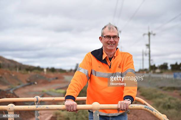 Ian Butler chief executive officer of Kalgoorlie Consolidated Gold Mines Ltd poses for a photograph near the company's super pit in Kalgoorlie...