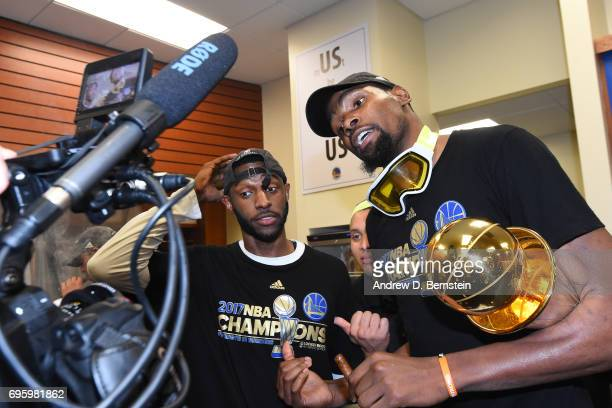 Ian Clark and Kevin Durant of the Golden State Warriors celebrate in the locker room after winning the NBA Championship against the Cleveland...