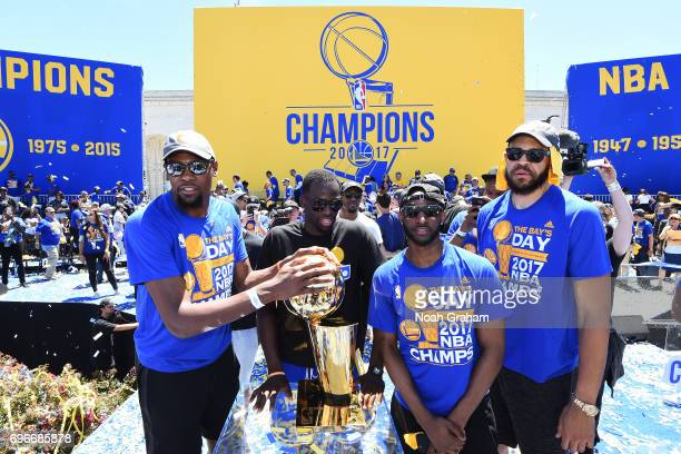 Ian Clark and Kevin Durant of the Golden State Warriors take a photo with the Larry O'Brien Trophy during the Victory Parade and Rally on June 15...