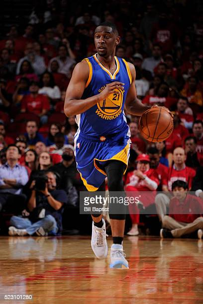 Ian Clark of the Golden State Warriors brings the ball up court against the Houston Rockets in Game Three of the Western Conference Quarterfinals...