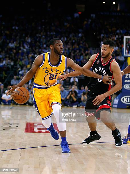 Ian Clark of the Golden State Warriors drives on Cory Joseph of the Toronto Raptors at ORACLE Arena on November 17 2015 in Oakland California NOTE TO...
