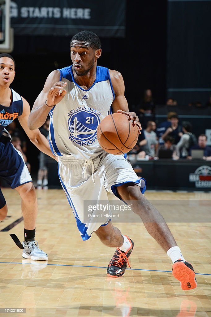 Ian Clark #21 of the Golden State Warriors drives under pressure during NBA Summer League game between the Charlotte Bobcats and the Golden State Warriors on July 21, 2013 at the Cox Pavilion in Las Vegas, Nevada.