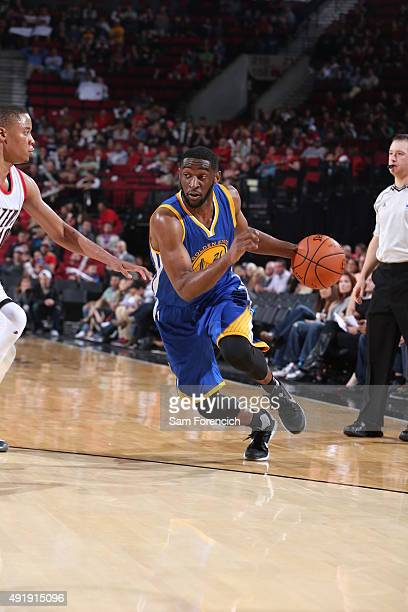 Ian Clark of the Golden State Warriors handles the ball against the Portland Trail Blazers during a preseason game on October 8 2015 at the Moda...