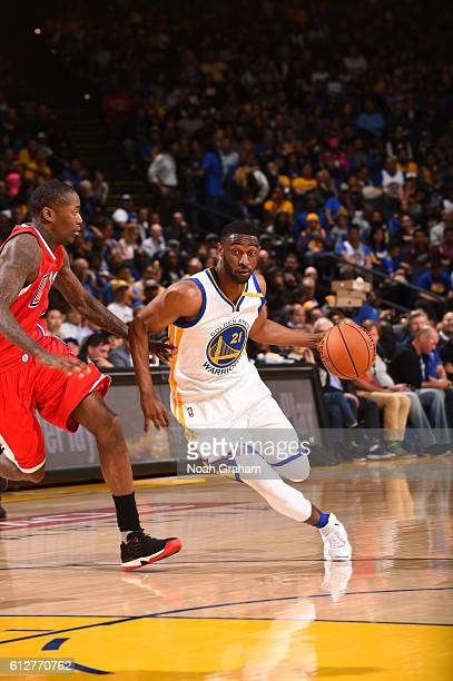 Ian Clark of the Golden State Warriors handles the ball against the Los Angeles Clippers during a preseason game on October 4 2016 at ORACLE Arena in...