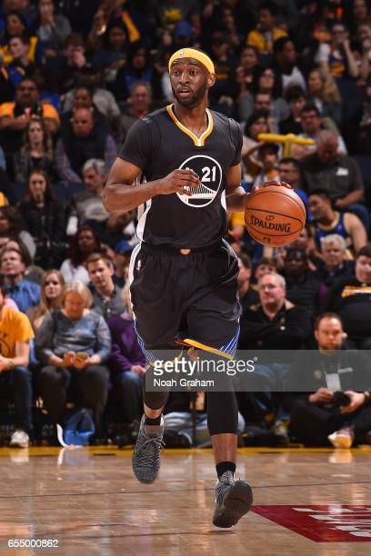Ian Clark of the Golden State Warriors handles the ball against the Milwaukee Bucks on March 18 2017 at ORACLE Arena in Oakland California NOTE TO...