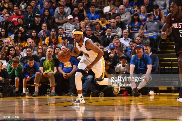 Ian Clark of the Golden State Warriors handles the ball during a game against the Houston Rockets on March 31 2017 at ORACLE Arena in Oakland...