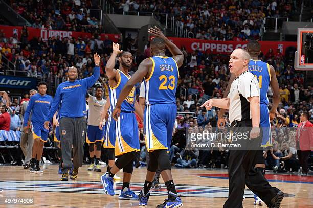 Ian Clark of the Golden State Warriors high fives Draymond Green of the Golden State Warriors during the game against the Los Angeles Clippers on...