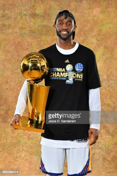 Ian Clark of the Golden State Warriors poses for a portrait with the Larry O'Brien Trophy after defeating the Cleveland Cavaliers in Game Five of the...