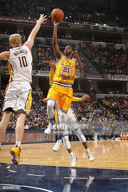 Ian Clark of the Golden State Warriors shoots against Chase Budinger of the Indiana Pacers on December 8 2015 at Bankers Life Fieldhouse in...