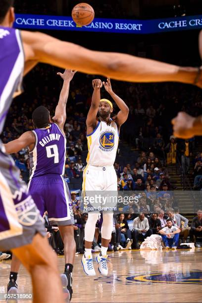 Ian Clark of the Golden State Warriors shoots the ball against the Sacramento Kings on March 24 2017 at ORACLE Arena in Oakland California NOTE TO...
