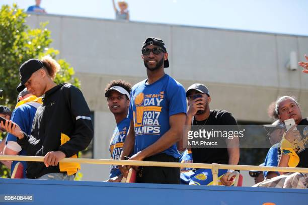 Ian Clark of the Golden State Warriors smiles to the crowd during the Victory Parade and Rally on June 15 2017 in Oakland California at The Henry J...