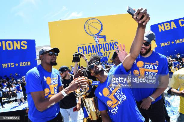 Ian Clark of the Golden State Warriors takes a 'selfie' with the Larry O'Brien Trophy on during the Victory Parade and Rally on June 15 2017 in...