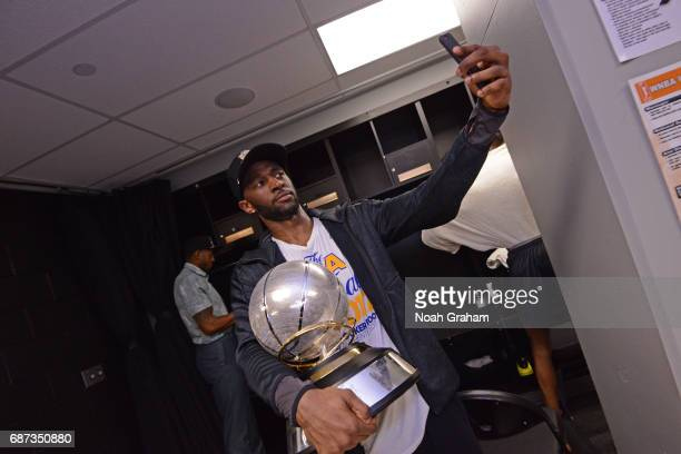 Ian Clark of the Golden State Warriors takes a 'selfie' with the Western Conference Championship Trophy after winning Game Four of the Western...