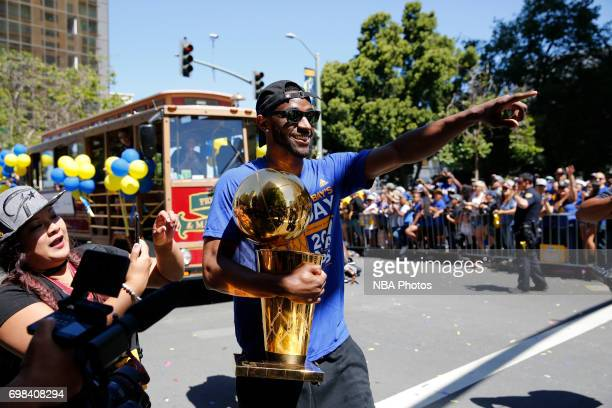 Ian Clark of the Golden State Warriors walks down the street with the Larry O'Brien Trophy during the Victory Parade and Rally on June 15 2017 in...