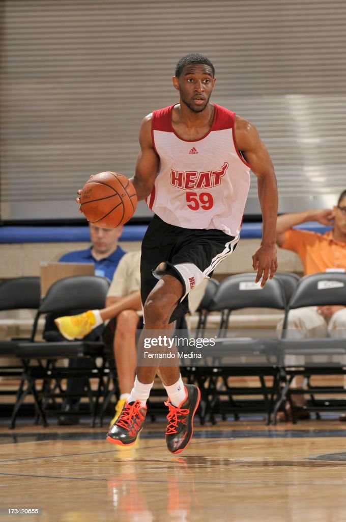 Ian Clark #59 of the Miami Heat drives up court during the 2013 Southwest Airlines Orlando Pro Summer League between the Detroit Pistons and the Miami Heat on July 12, 2013 at Amway Center in Orlando, Florida.
