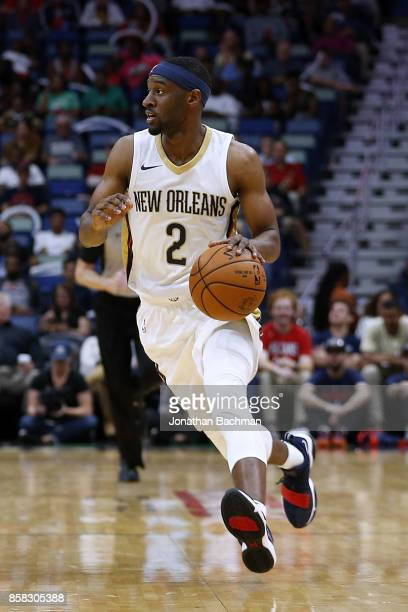 Ian Clark of the New Orleans Pelicans drives with the ball during a preseason game against the Chicago Bulls at the Smoothie King Center on October 3...