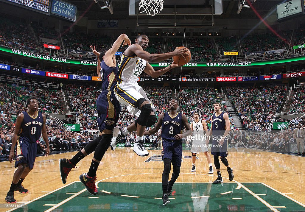 Ian Clark #21 of the Utah Jazz puts up a shot against Anthony Davis #23 of the New Orleans Pelicans at EnergySolutions Arena on April 04, 2014 in Salt Lake City, Utah.