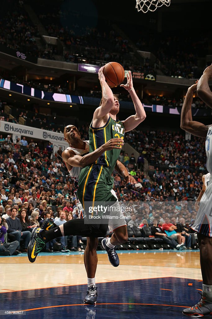 Ian Clark #21 of the Utah Jazz shoots against the Charlotte Bobcats during the game at the Time Warner Cable Arena on December 21, 2013 in Charlotte, North Carolina.