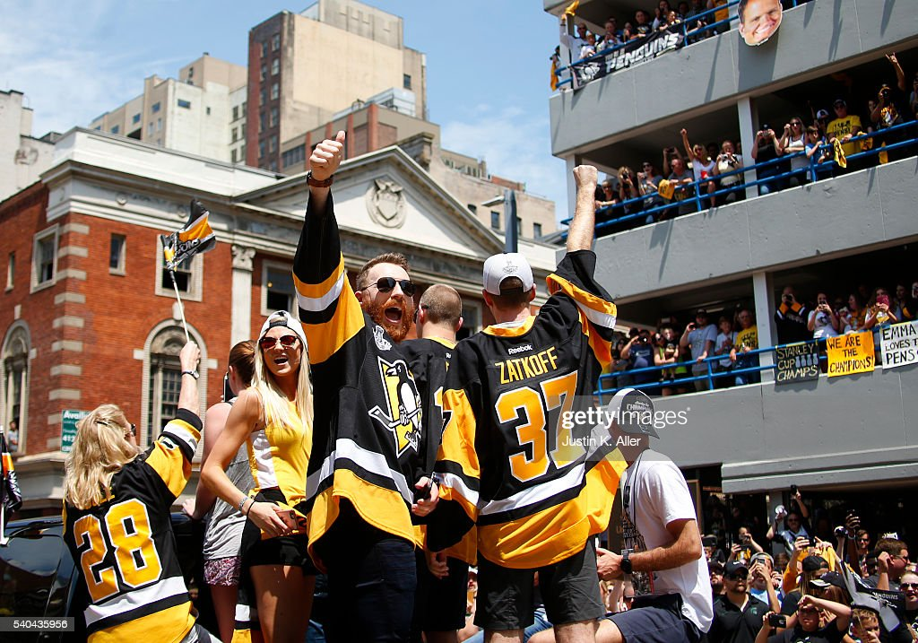 Ian Cole #28 and Jeff Zatkoff #37 of the Pittsburgh Penguins celebrate during the Victory Parade and Rally on June 15, 2016 in Pittsburgh, Pennsylvania. The Penguins defeated the San Jose Sharks to win the NHL Stanley Cup.