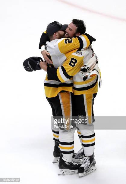 Ian Cole celebrates with Brian Dumoulin of the Pittsburgh Penguins after defeating the Nashville Predators to win the 2017 NHL Stanley Cup Final at...