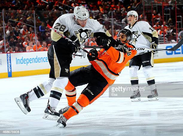 Ian Cole of the Pittsburgh Penguins checks PierreEdouard Bellemare of the Philadelphia Flyers in the second period on April 5 2015 at the Wells Fargo...