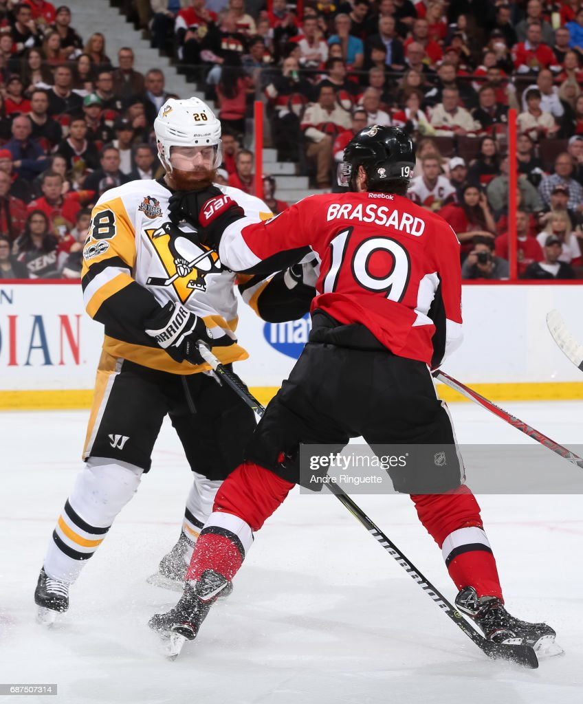 Ian Cole #28 of the Pittsburgh Penguins clashes with Derick Brassard #19 of the Ottawa Senators in Game Six of the Eastern Conference Final during the 2017 NHL Stanley Cup Playoffs at Canadian Tire Centre on May 23, 2017 in Ottawa, Ontario, Canada.
