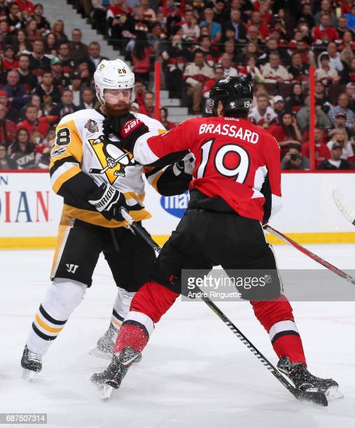 Ian Cole of the Pittsburgh Penguins clashes with Derick Brassard of the Ottawa Senators in Game Six of the Eastern Conference Final during the 2017...