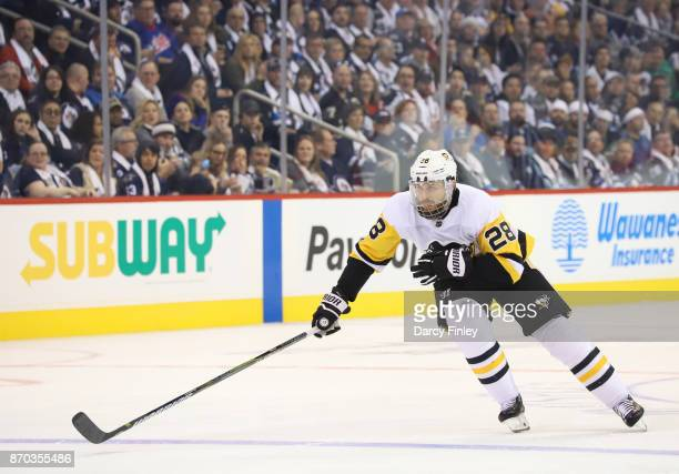 Ian Cole of the Pittsburgh Penguins follows the play down the ice during second period action against the Winnipeg Jets at the Bell MTS Place on...
