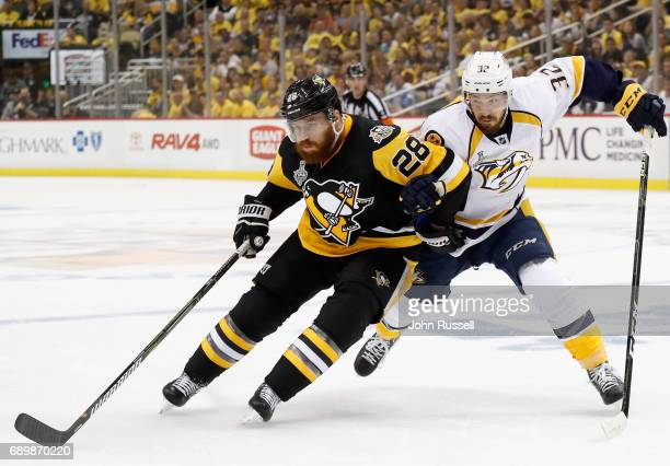 Ian Cole of the Pittsburgh Penguins plays against Frederick Gaudreau of the Nashville Predators during the second period of Game One of the 2017 NHL...