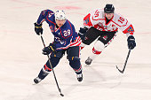 Ian Cole of the USA controls the puck against Andrew Gordon of Canada during the International Ice Hockey Invitational match between Canada and the...