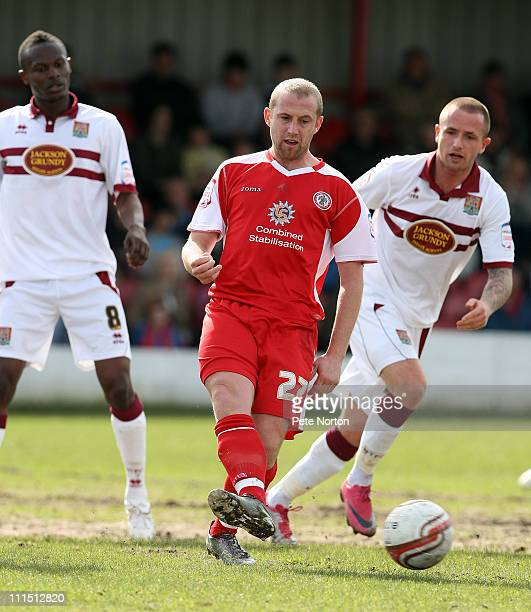 Ian Craney of Accrington Stanley pays the ball watched by Josh Walker and Abdul Osman of Northampton Town during the npower League Two League match...
