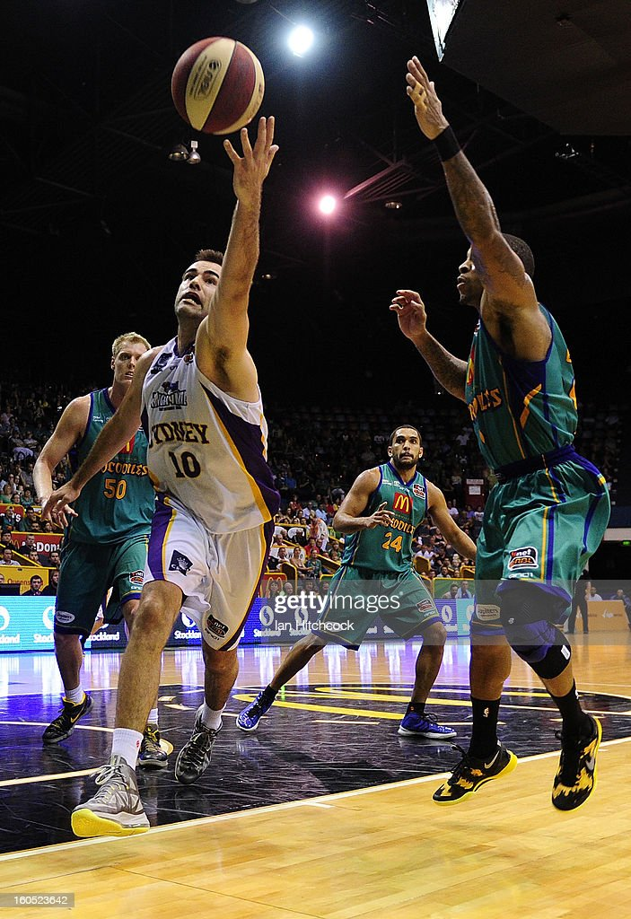 Ian Crosswhite of the Kings contests the ball with Gary Ervin of the Crocodiles during the round 17 NBL match between the Townsville Crodcodiles and the Sydney Kings at Townsville Entertainment Centre on February 2, 2013 in Townsville, Australia.