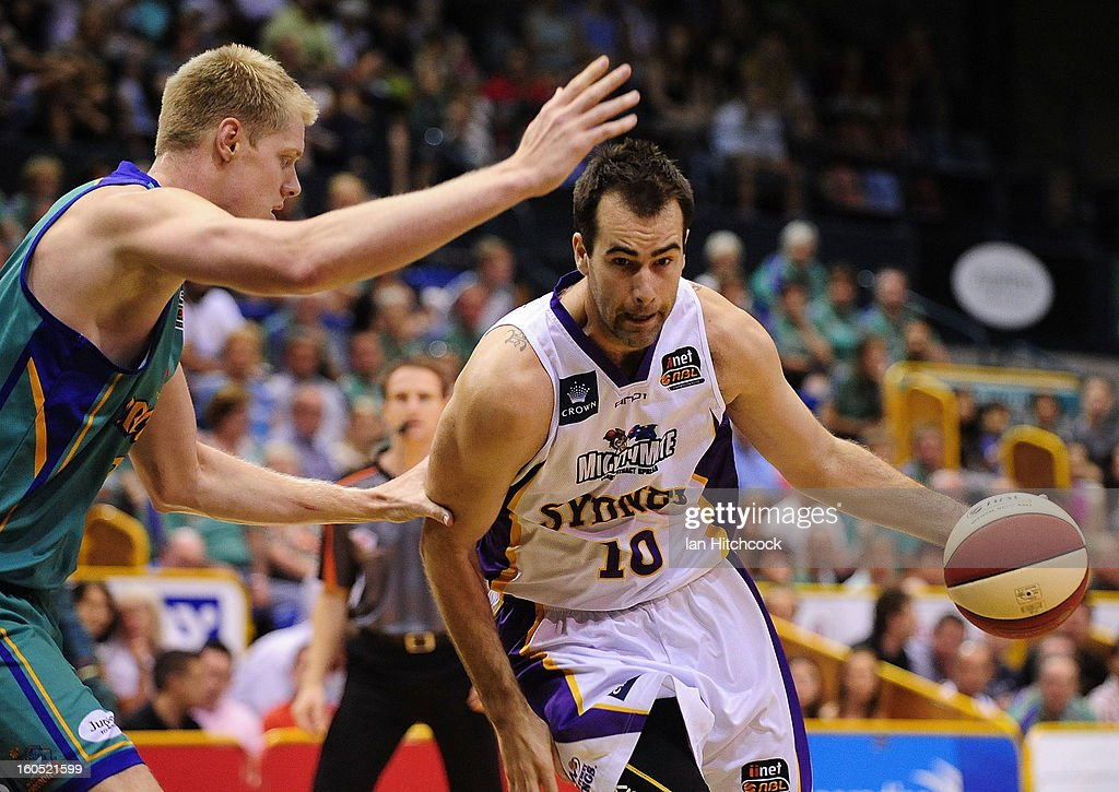 Ian Crosswhite of the Kings looks to get past Luke Nevill of the Crocodiles during the round 17 NBL match between the Townsville Crodcodiles and the Sydney Kings at Townsville Entertainment Centre on February 2, 2013 in Townsville, Australia.