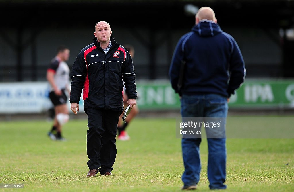 Ian Davies Head Coach of Cornish Pirates walks to greet Mike Rayer Bedford Blues' Director of Rugby following the British Irish Cup match between...