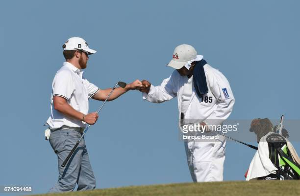 Ian Davis of the United States reacts to making a birdie putt on the 15th hole during the third round of the PGA TOUR Latinoamérica Honduras Open...