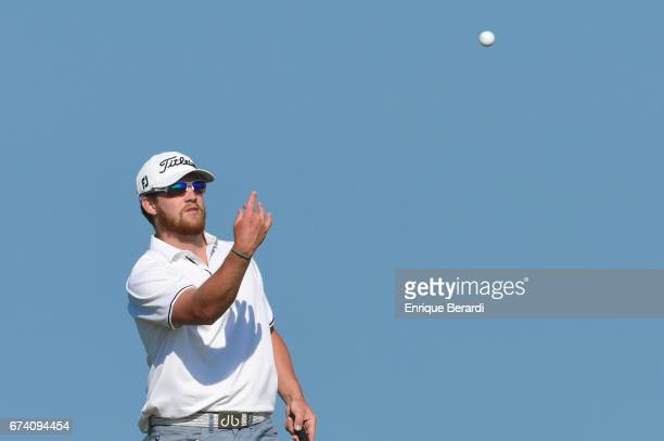 Ian Davis of the United States throws his ball to his caddie at the 16th hole during the third round of the PGA TOUR Latinoamérica Honduras Open...